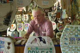Barney Smith poses with some of the 600 exhibits Thursday, May 10, 2001 at his Toilet Seat Museum.