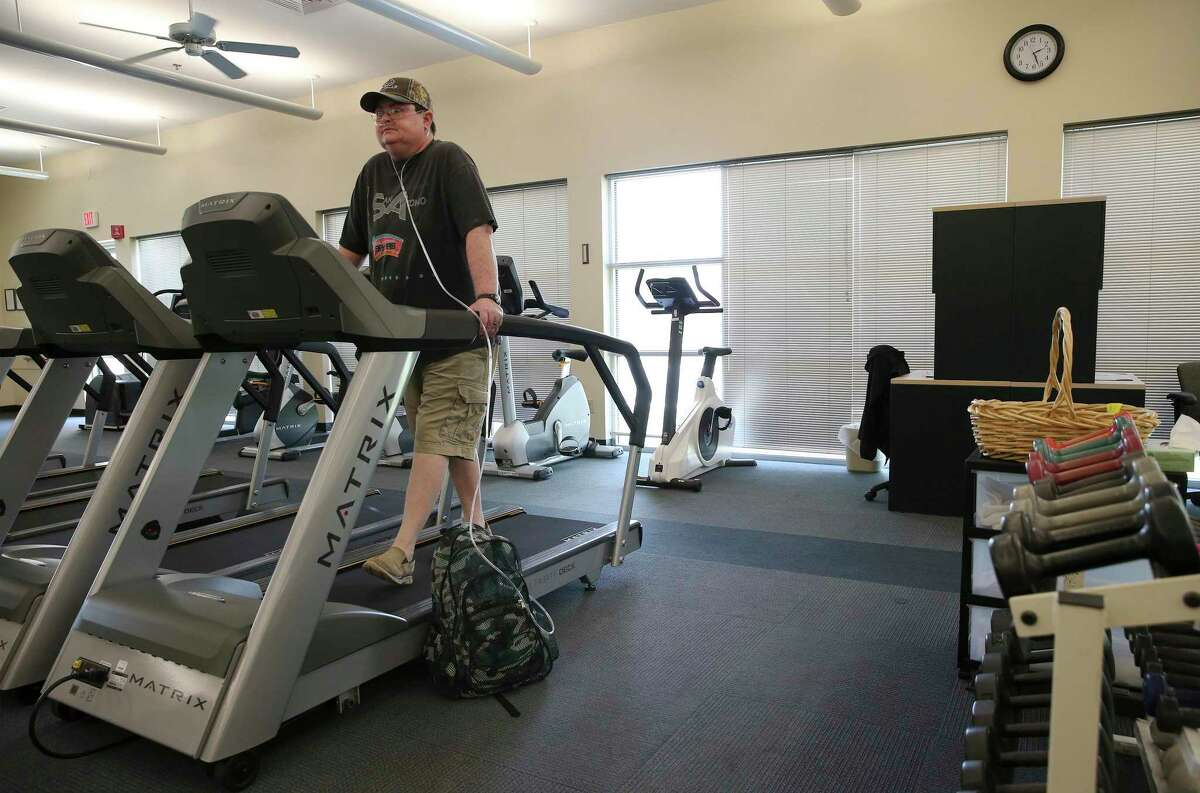 Schertz resident Amy Blair walks on a treadmill as she attends therapy at Christus Santa Rosa Rehab Services in New Braunfels on Friday, July 19, 2019. Blair had a default judgment issued against her for unpaid credit card debt. Blair suffers from pulmonary illness and fighting a rejection of a lung transplant from 2014. She medically retired as a police officer. (Kin Man Hui/San Antonio Express-News)