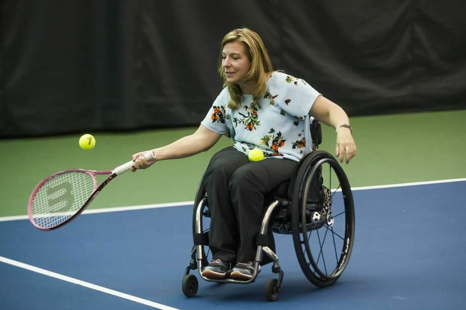 Mary Kunz of Auburn participates in a wheelchair tennis clinic on Thursday, July 18, 2019 at Greater Midland Tennis Center. (Katy Kildee/kkildee@mdn.net) Photo: (Katy Kildee/kkildee@mdn.net)