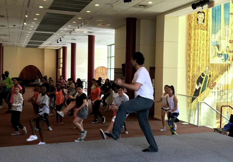 """""""In the Heights"""" assistant choreographer Luis Salgado leads a group of aspiring young performers in choreography at The Palace Theatre's Triple Threat Performer Intensive. Photo: The Palace Theatre / Contributed Photo"""