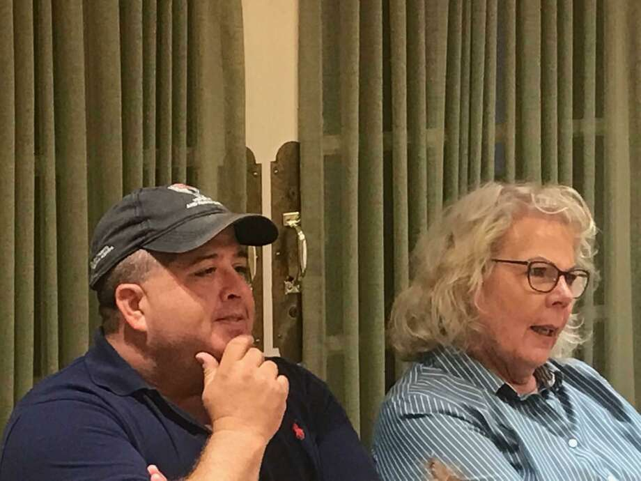 Cheshire Town Council Members Jeff Falk and Patti Flynn-Harris watch as the Democratic Town Committee nominates them to run for another term during a party caucus held Tuesday night at the Cheshire Senior Center. Photo: Luther Turmelle / Hearst Connecticut Media