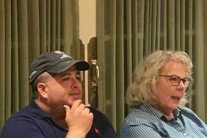 Cheshire Town Council Members Jeff Falk and Patti Flynn-Harris watch as the Democratic Town Committee nominates them to run for another term during a party caucus held Tuesday night at the Cheshire Senior Center.
