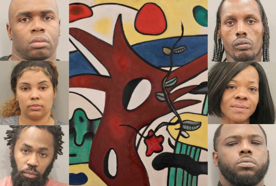 See the suspects' mugshots and missing artwork >>> Photo: Houston Police Department