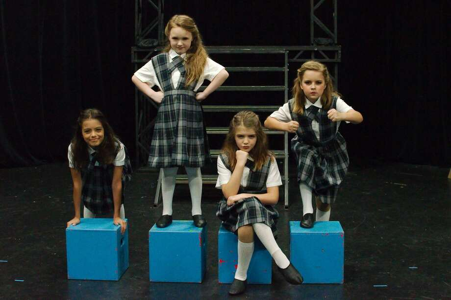 """Hannah Holguin, left, Olivia Powell, Colette Garcia and Heather Korth alternate in the starring role of The Jet-Pac's production of """"Matilda the Musical"""" in Webster. Photo: Kirk Sides/Staff Photographer"""