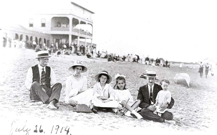 The Tarlton family in front of the Fairfield Beach Club. Photo: Contributed Photo