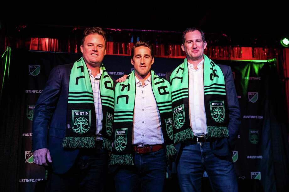 From left, Anthony Precourt, Josh Wolff and Andy Loughnane pose for a photo during a news conference in Austin on Tuesday, July 23, 2019. Former U.S. men's national team player and current assistant coach Josh Wolff will be the first head coach of Austin FC, the new Major League Soccer franchise that is scheduled to begin play in 2021. (Lola Gomez/Austin American-Statesman via AP) Photo: Lola Gomez, Associated Press / Austin America-Statesman
