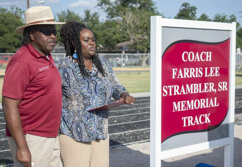 Jerry Strambler joins his niece, Tekeira Strambler Ray as she honors her late father, Farris Strambler, Sr. during the dedication ceremony 07/23/19 for the re-naming of the Lee High track, the Coach Farris Lee Strambler, Sr. Memorial Track. Tim Fischer/Reporter-Telegram Photo: Tim Fischer/Midland Reporter-Telegram
