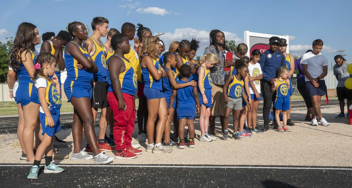 Members of the current Tall City Christian Track Club help at the dedication ceremony 07/23/19 for the re-naming of the Lee High track, the Coach Farris Lee Strambler, Sr. Memorial Track. Strambler founded the club in 1979. Tim Fischer/Reporter-Telegram