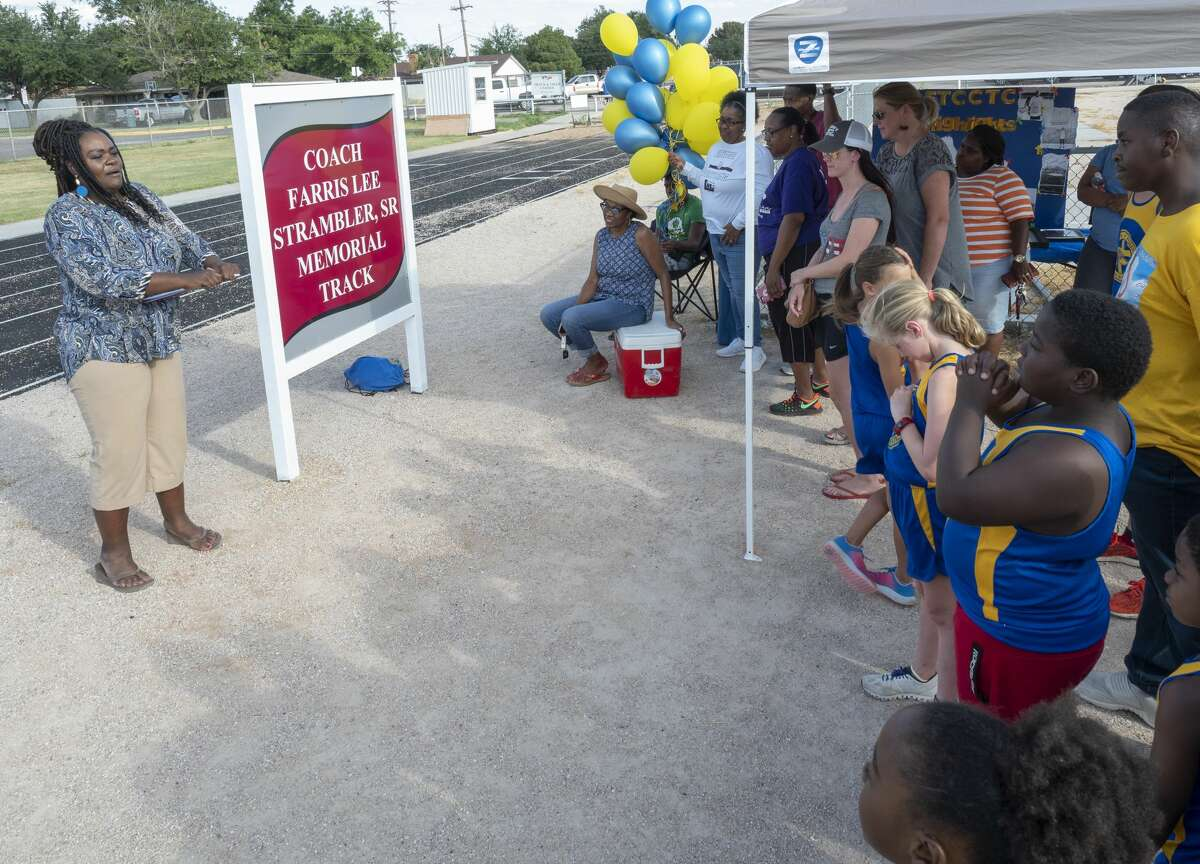 Tekeira Strambler Ray welcomes everyone as she honors her late father, Farris Strambler, Sr. during the dedication ceremony 07/23/19 for the re-naming of the Lee High track, the Coach Farris Lee Strambler, Sr. Memorial Track. Tim Fischer/Reporter-Telegram