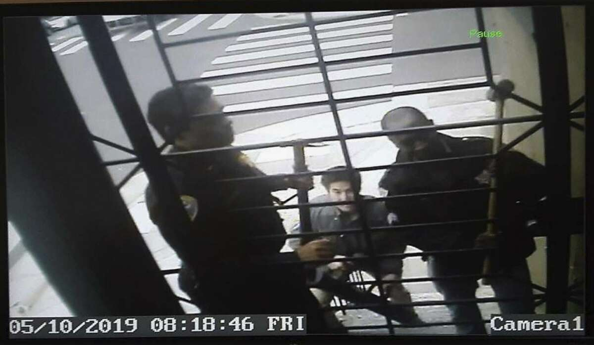 FILE - In this May 10, 2019, file image, taken from video provided by Bryan Carmody, San Francisco police armed with sledgehammers execute a search warrant at journalist Bryan Carmody's home in San Francisco. Documents released Tuesday, July 23, 2019, reveal that in seeking court approval to search a man's cellphone records to uncover who leaked a confidential police report to him, investigators at the San Francisco Police Department didn't tell a judge the man is a freelance journalist. (Bryan Carmody/@bryanccarmody via AP, File)