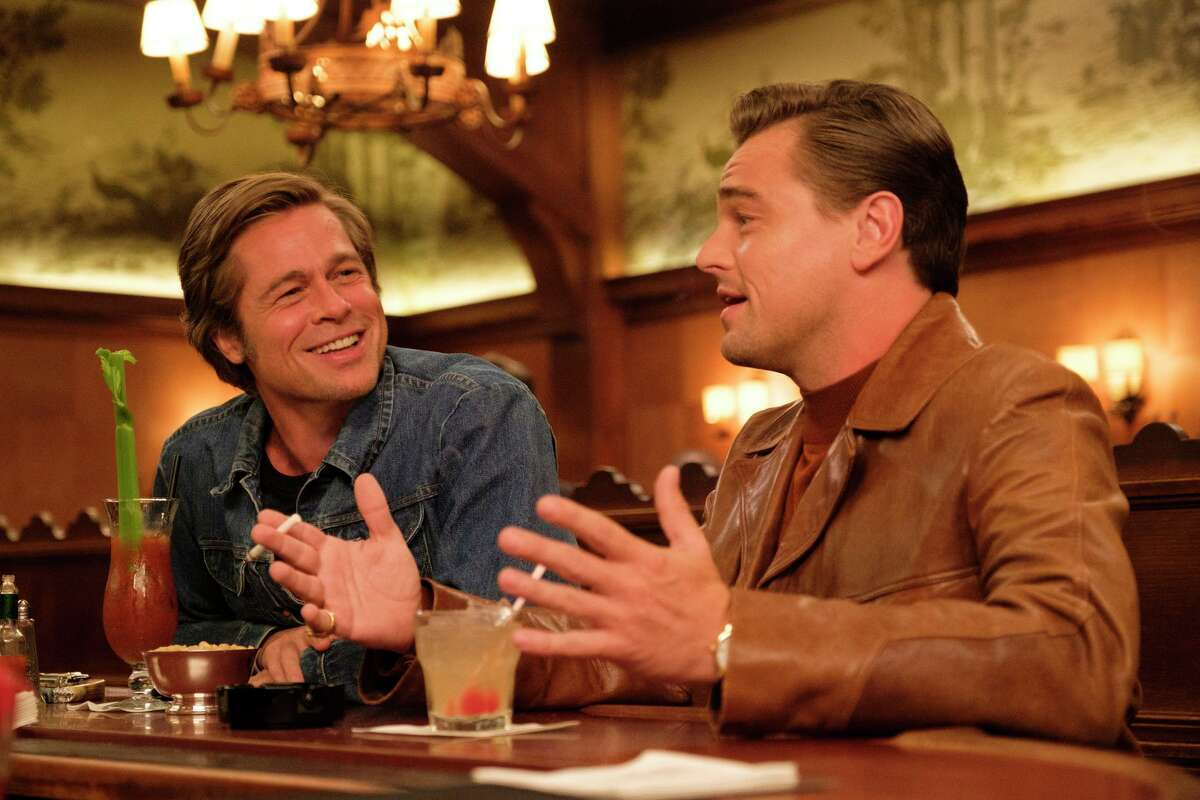 """This image released by Sony Pictures shows Brad Pitt, left, and Leonardo DiCaprio in Quentin Tarantino's """"Once Upon a Time in Hollywood."""" (Andrew Cooper/Sony-Columbia Pictures via AP)"""