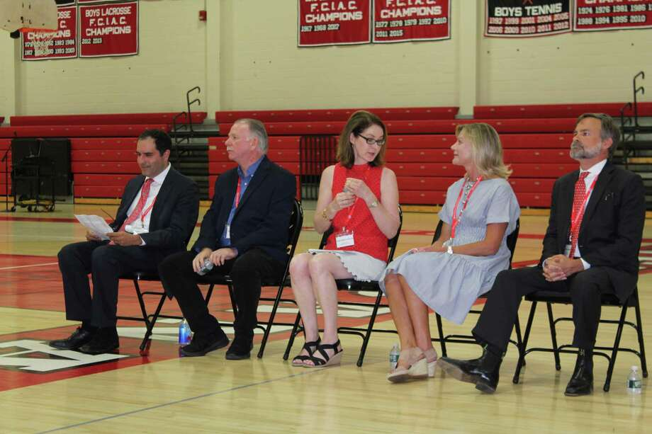 Board of Education candidates Danile LaGattuta, Bob Naughton, Julia Mackle Reeves, Suzanne Harrison and Carl Gardiner are introduced by state Rep. Tom O'Dea at the New Canaan Republican Caucus on Tuesday, July 16, at New Canaan High School. Gardiner, Naughton and Mackle Reeves won the three nominations up for grabs. Photo: John Kovach / Hearst Connecticut Media / New Canaan Advertiser