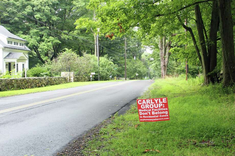 The group Neighbors For Neighborhood Preservation has placed signs around Greenfield Hill. Photo: Rachel Scharf / Hearst Media Connecticut