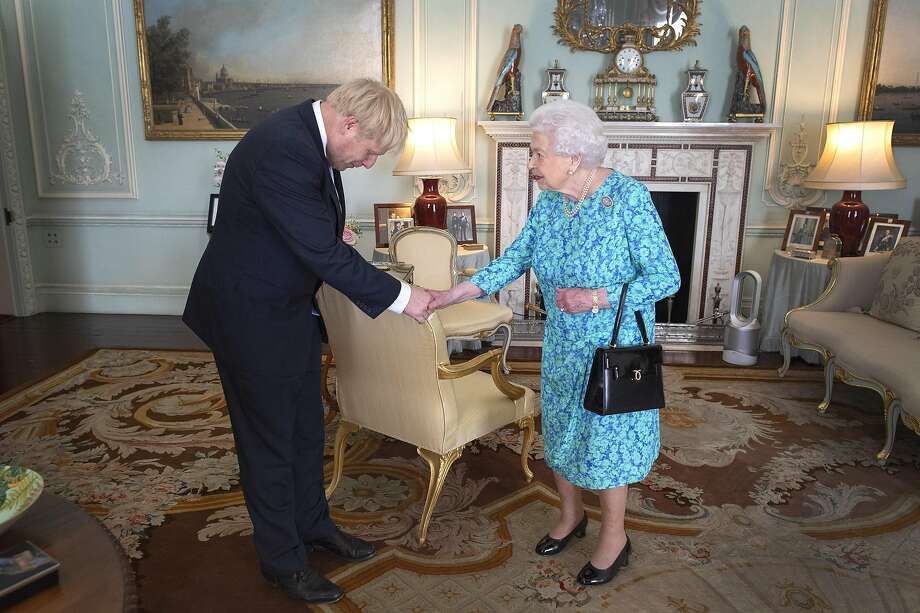 Queen Elizabeth II welcomes new Prime Minister Boris Johnson at Buckingham Palace in London. Photo: Getty Images