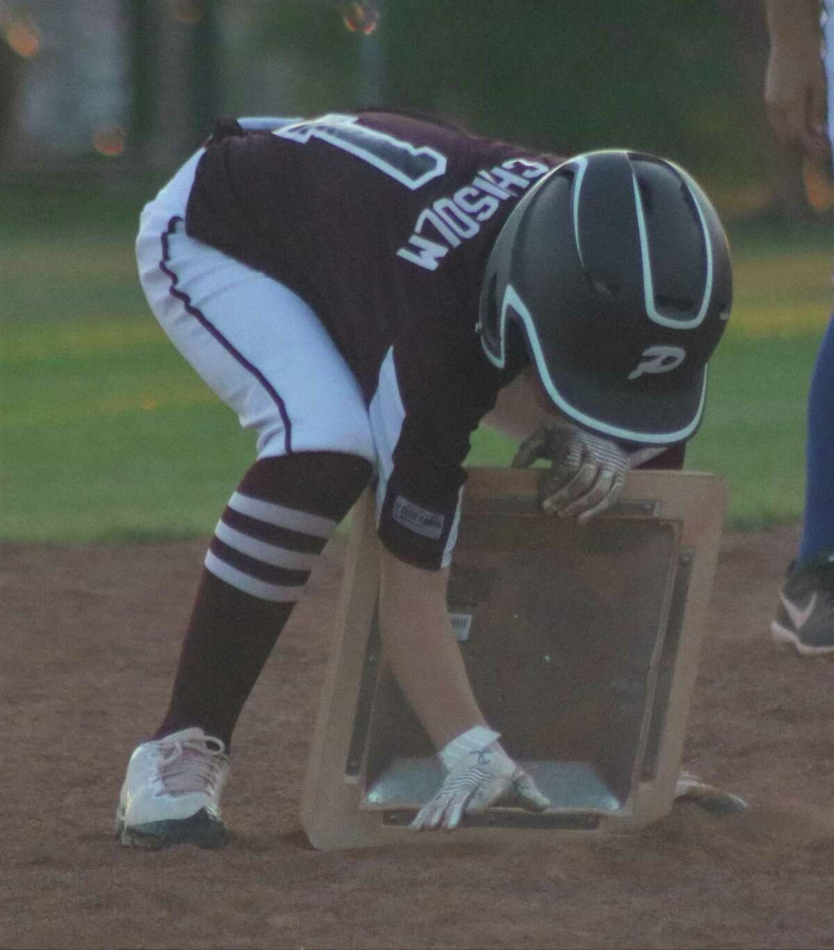 Pearland East All-Star Colt Chisolm fixes the second-base bag after hitting a fourth-inning double in Tuesday night's state championship game in Tyler.