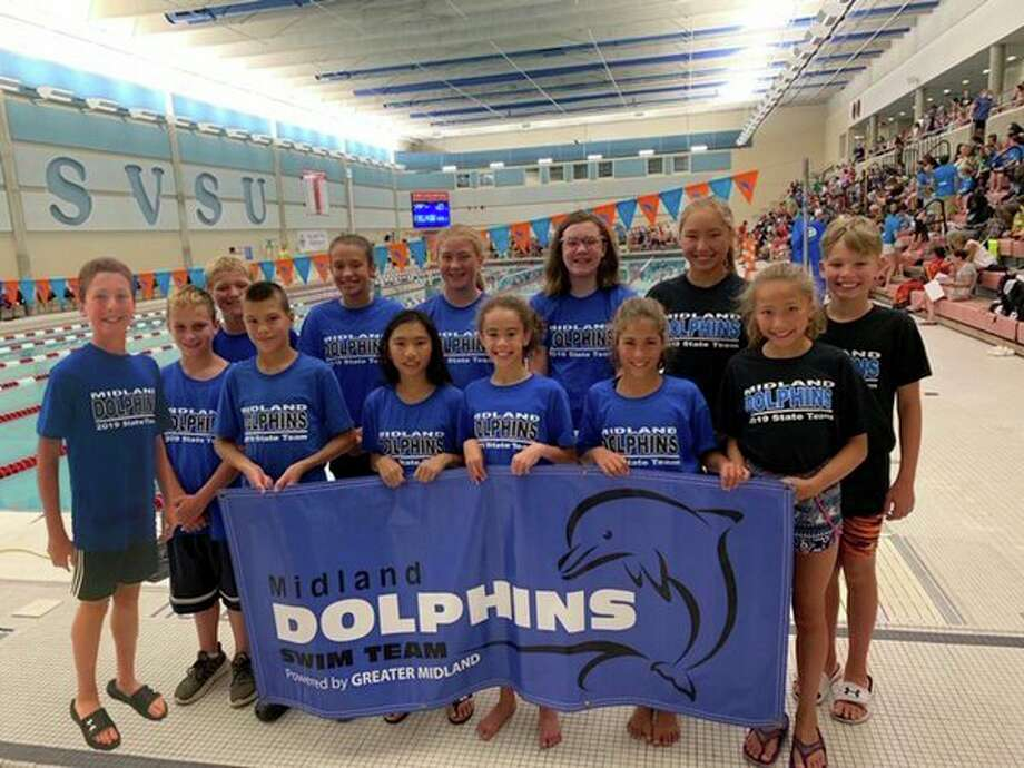 Members of the Midland Dolphins swim team pose for a photo at the state meet held Saturday at Saginaw Valley State University. Pictured are front row, from left: Eli Soderberg, Ransom Kurzer, Sam Buck, Amy Casipit, Avery Johnson, Sydney Buck, Vera Roberson; (back row, from left) Gabe Soderberg, Jordan Johnson, Emily Thackery, Emmy Sower, Ella Roberson and Will Blakeley. (Photo provided)