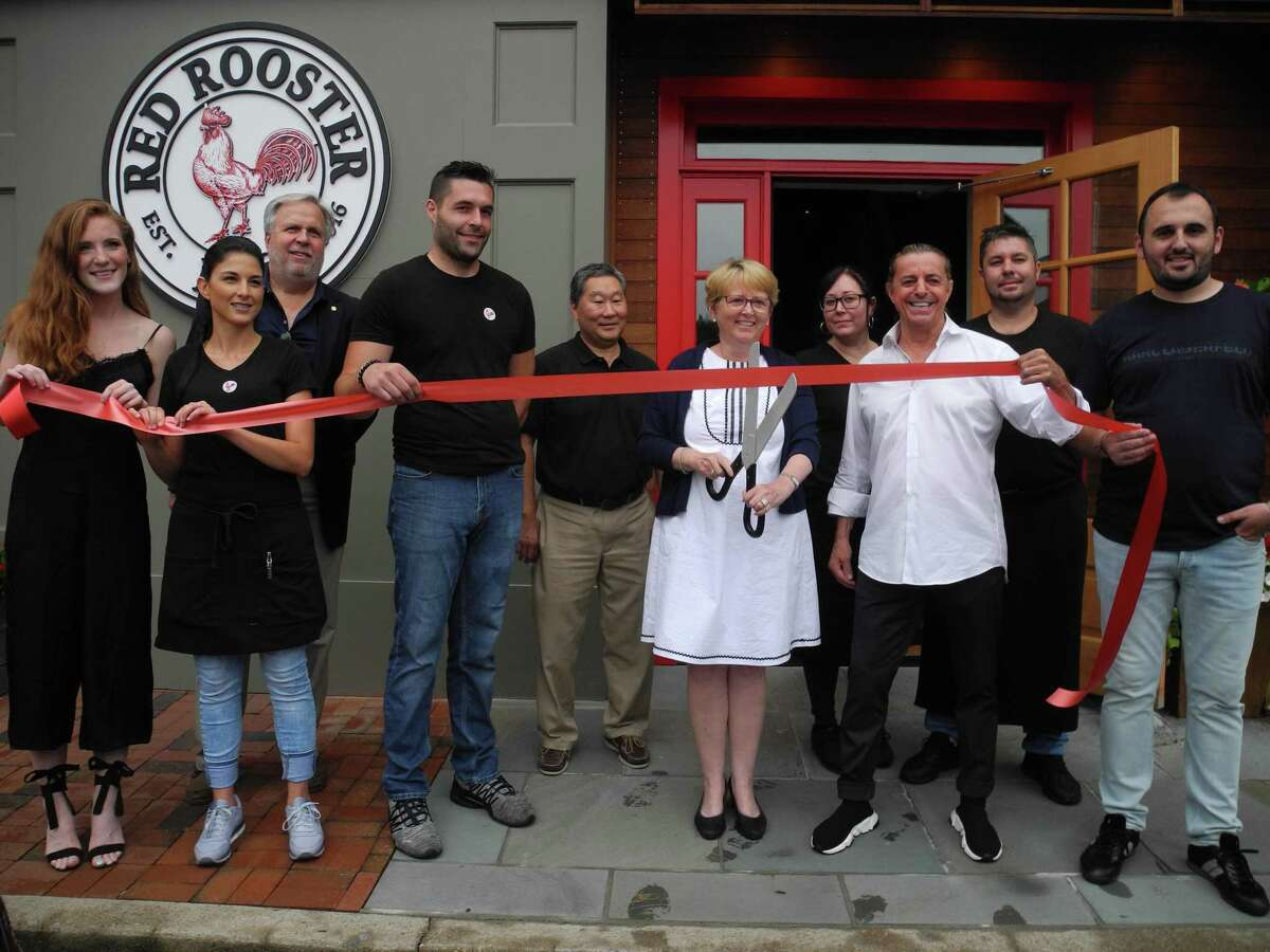 At the ribbon-cutting for Red Rooster on July 23 were, from left, Shannon Quinlan, Alejandra Perez, Chamber board member Patrick Russo, Sal Trichilo, Chamber board member Tom Sato, First Selectwoman Lynne Vanderslice, Fabiana DeOliveira, owner Tony Ramadini, Louis Rezende and Damir Bislimi.