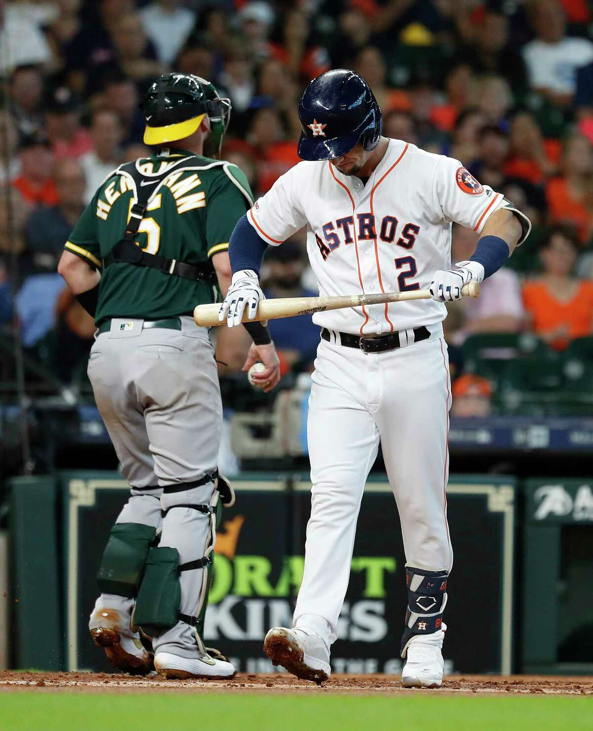 Houston Astros Alex Bregman (2) reacts after striking out against Oakland Athletics starting pitcher Chris Bassitt (40) during the first inning of an MLB baseball game at Minute Maid Park, Wednesday, July 24, 2019.