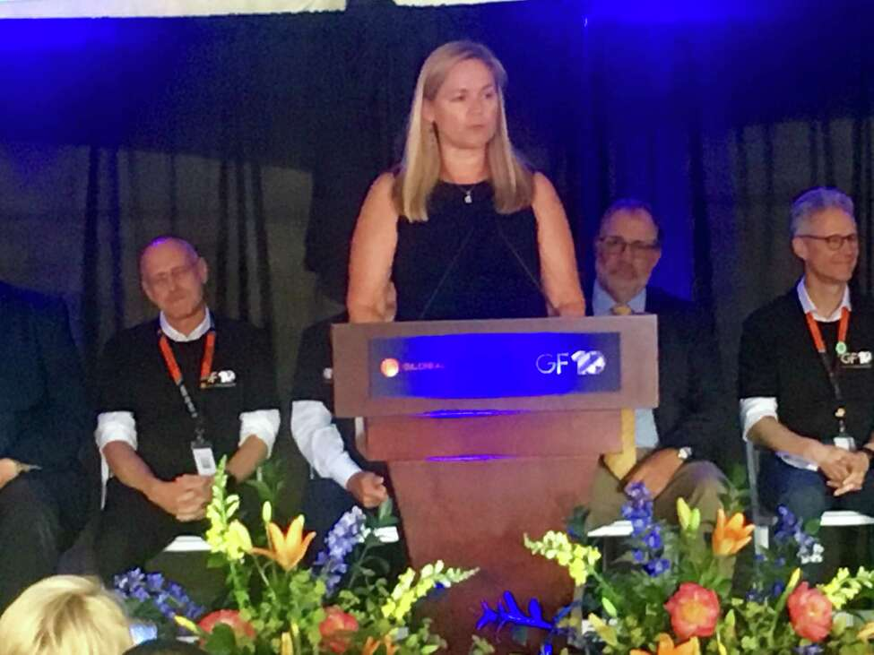 Emily Reilly, employee No. 1 at GlobalFoundries, speaks Wednesday at the company's 10-year anniversary celebration of its Fab 8 factory in Malta