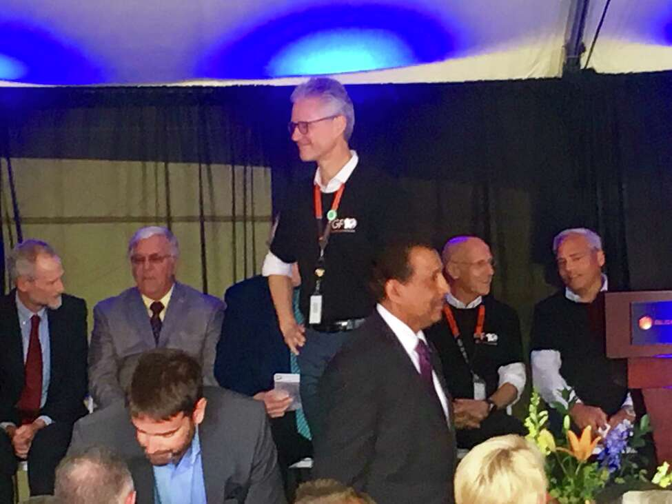 Ron Sampson, head of GlobalFoundries' U.S. operations, leading Wednesday's anniversary celebration of its Fab 8 factory. Ground was broken on the facility 10 years ago.