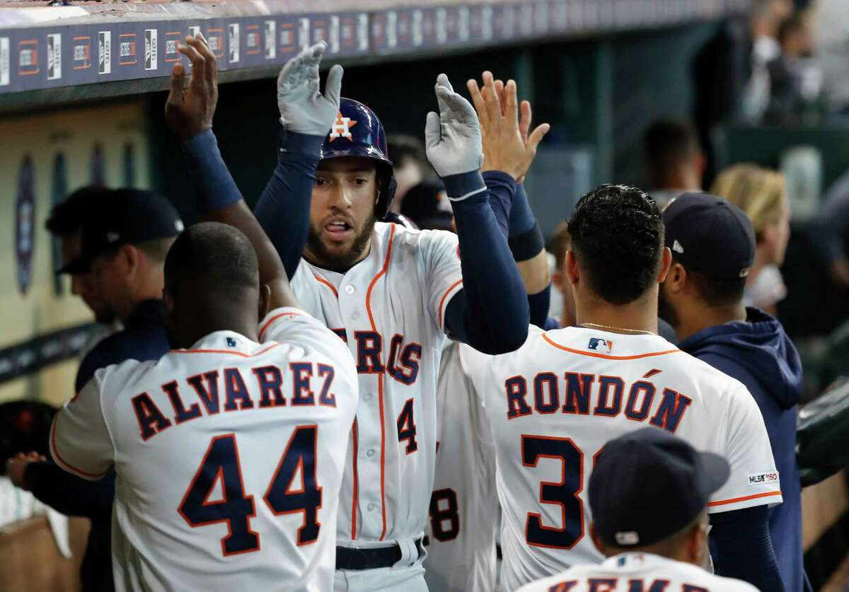 Houston Astros George Springer (4) celebrates with Yordan Alvarez (44) after hitting a two-run home run during the third inning of an MLB baseball game at Minute Maid Park, Wednesday, July 24, 2019.