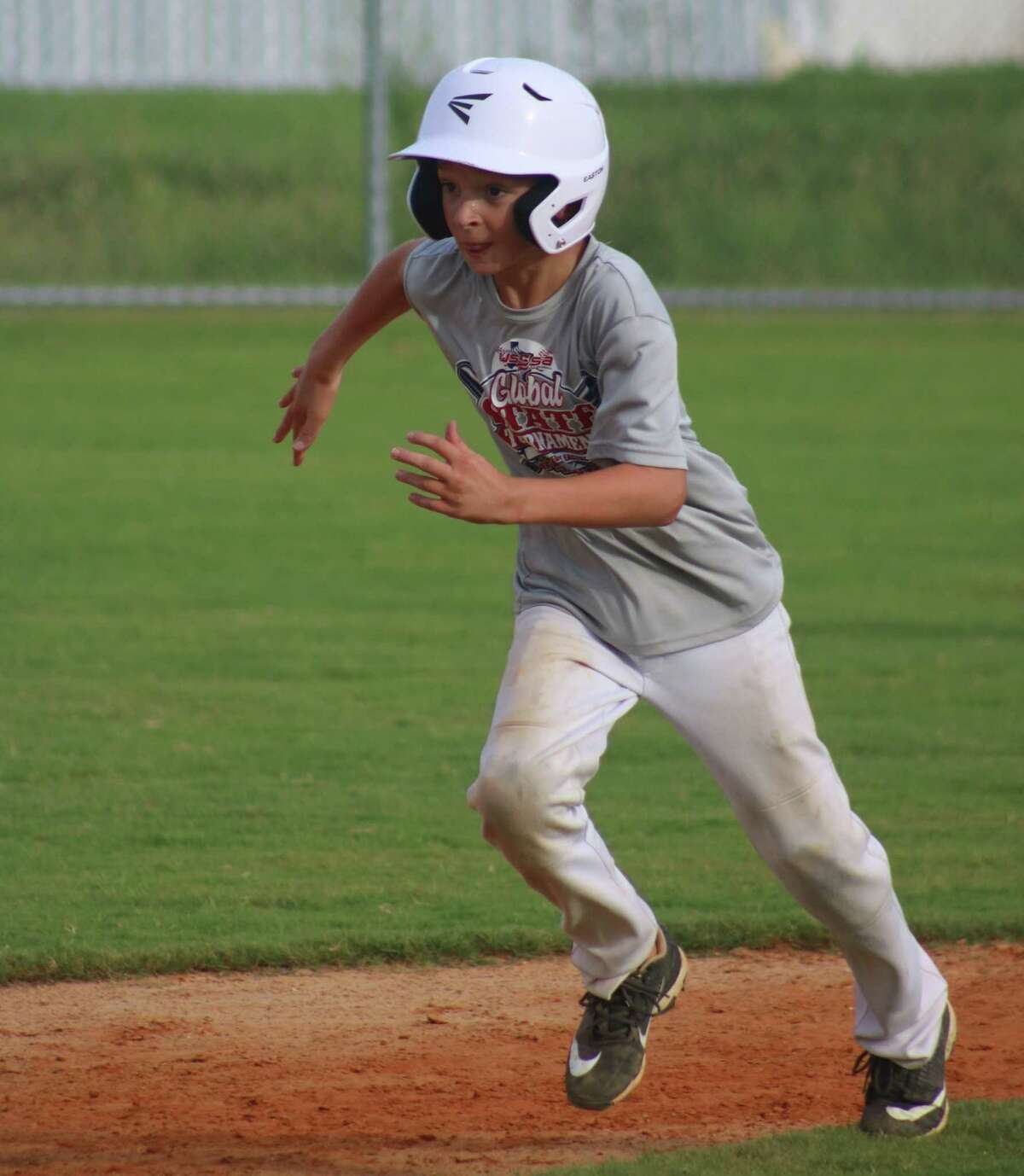 Deer Park's Cash Monson runs the bases during one of the team's final practices before the team starts the South Zone Tournament in Louisiana that begins Wednesday.