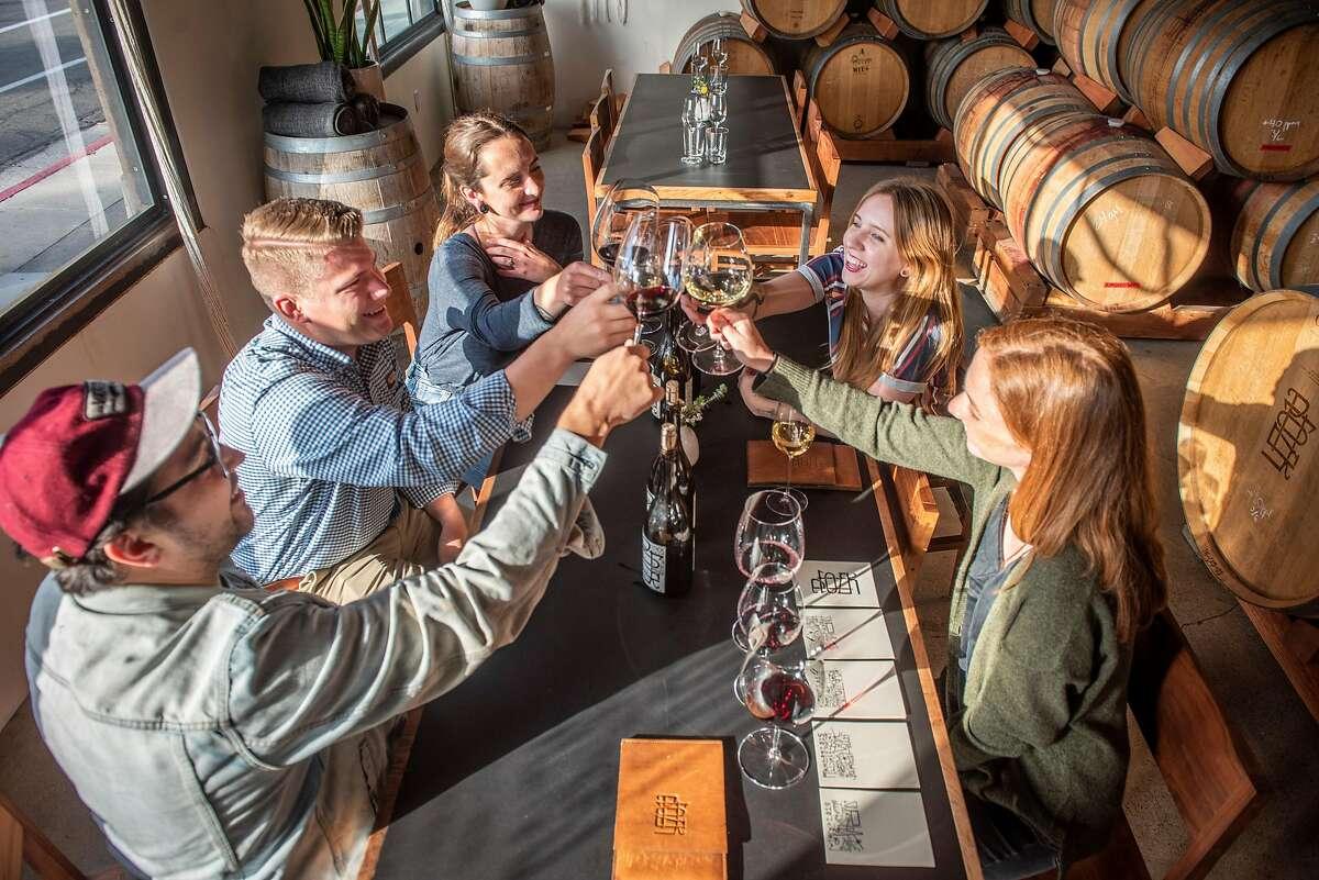 Wine tasters from the left Kyle Dickie, Alec Sackett, Rhiannon Garrity, Jerelyn Barber and Olivia Essen all from Santa Barbara, toast in the Potek Winery Tasting Room on Wednesday, April 24, 2019, in Santa Barbara, Ca.