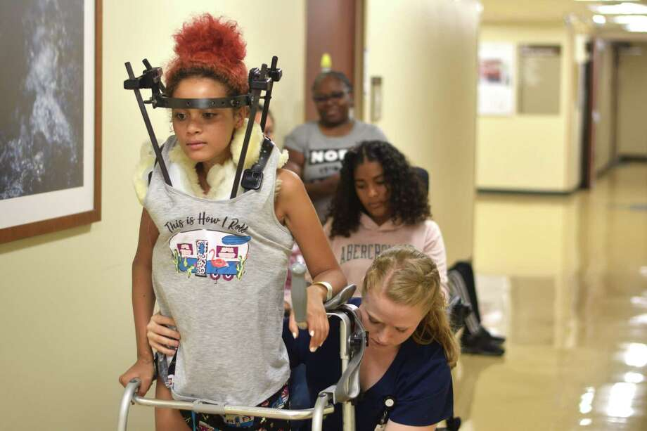 Lacy has been in rehabilitation at TIRR Memorial Herman Rehabilitation and Research facility, where she is learning to walk again while function comes back to the left side of her body and gaining more control over her left arm with the help of the staff Photo: Chevall Pryce