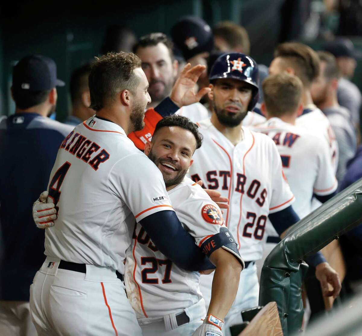 Houston Astros Jose Altuve (27) celebrates his two-run home run with George Springer (4) during the fifth inning of an MLB baseball game at Minute Maid Park, Wednesday, July 24, 2019.