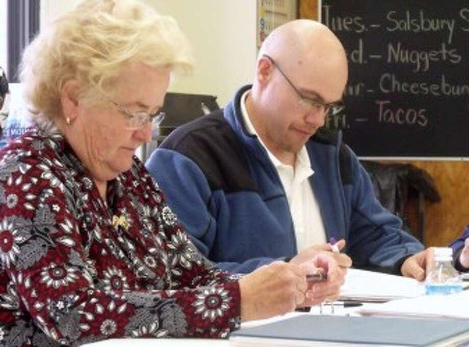 MONEY MATTERS: Chippewa Hills School District finance director Sandy Weir (left) gives a budget update at a past board meeting. (Pioneer file photo)
