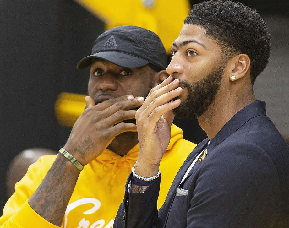 Los Angeles Lakers NBA basketball players, LeBron James, left, and Anthony Davis share a moment after David was introduced at a news conference at the UCLA Health Training Center in El Segundo, Calif., Saturday, July 13, 2019. (AP Photo/Damian Dovarganes) Photo: Damian Dovarganes / Associated Press