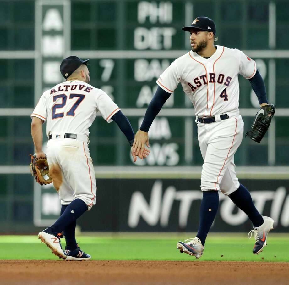 Jose Altuve (27) of the Houston Astros celebrates with George Springer (4) after the game against the Oakland Athletics at Minute Maid Park on July 24, 2019 in Houston. Photo: Tim Warner, Stringer / Getty Images / 2019 Getty Images