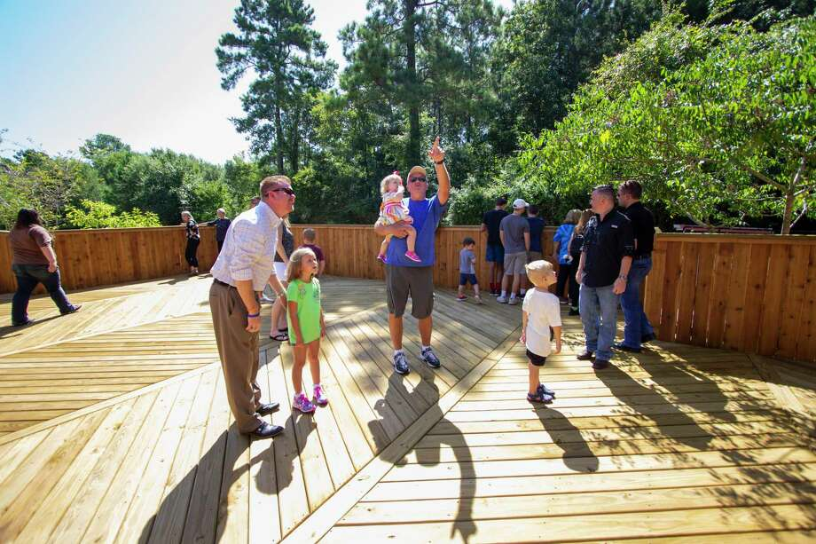 Visitors walk around a newly built deck area Wednesday, July 24, 2019 at the Spring Creek Greenway Nature Center in Spring. The center is planning a grand reopening Aug. 3 after being shut down because of flooding during Hurricane Harvey. Photo: Cody Bahn, Houston Chronicle / Staff Photographer / © 2019 Houston Chronicle