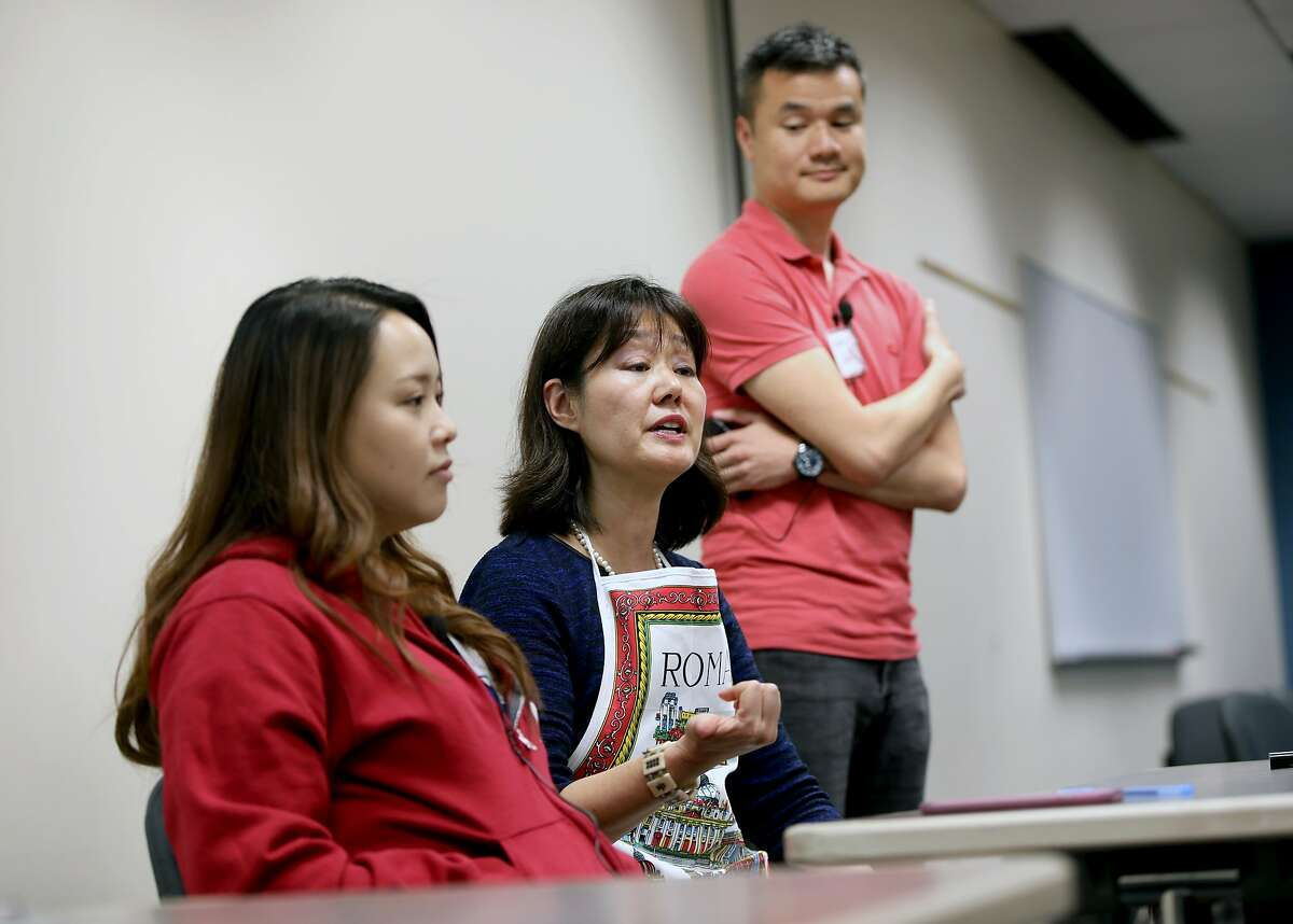 Eun Kyung Joanne Lee (left), MD, MS Stanford psychiatry resident, Dr. Rona Hu, clinical associate professor, psychiatry and behavioral sciences, Stanford University, and Steve Sust, MD, child and adolescent psychiatrist, Stanford University, discuss a skit in the Milton Marks Auditorium at the California State Building in San Francisco, Calif., on Friday, May 11, 2019. Stanford CHIPAO, or the Communication Health Interactive for Parents of Adolescents and Others, puts on plays and skits to help Chinese American families better understand the mental health needs of their children.