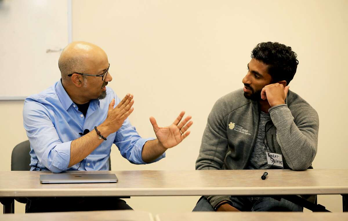 During a skit, Dr. Shashank V. Joshi (left), associate professor and director of school mental health, Stanford University, interacts with Bharat Sampathi, medical student, University of California, Irvine School of Medicine, in the Milton Marks Auditorium at the California State Building in San Francisco, Calif., on Friday, May 11, 2019. Stanford CHIPAO, or the Communication Health Interactive for Parents of Adolescents and Others, puts on plays and skits to help Chinese American families better understand the mental health needs of their children.