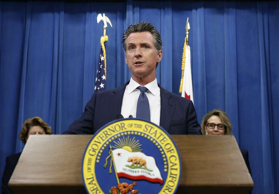Gov. Gavin Newsom discusses a report detailing efforts by the Department of Motor Vehicles to improve customer services during a news conference in Sacramento., Tuesday, July 23, 2019. Some of the suggestions are to accept credit cards, upgrade the DMV's website and offer clearer instructions on how to obtain a new federally mandated ID.(AP Photo/Rich Pedroncelli) Photo: Rich Pedroncelli / Associated Press