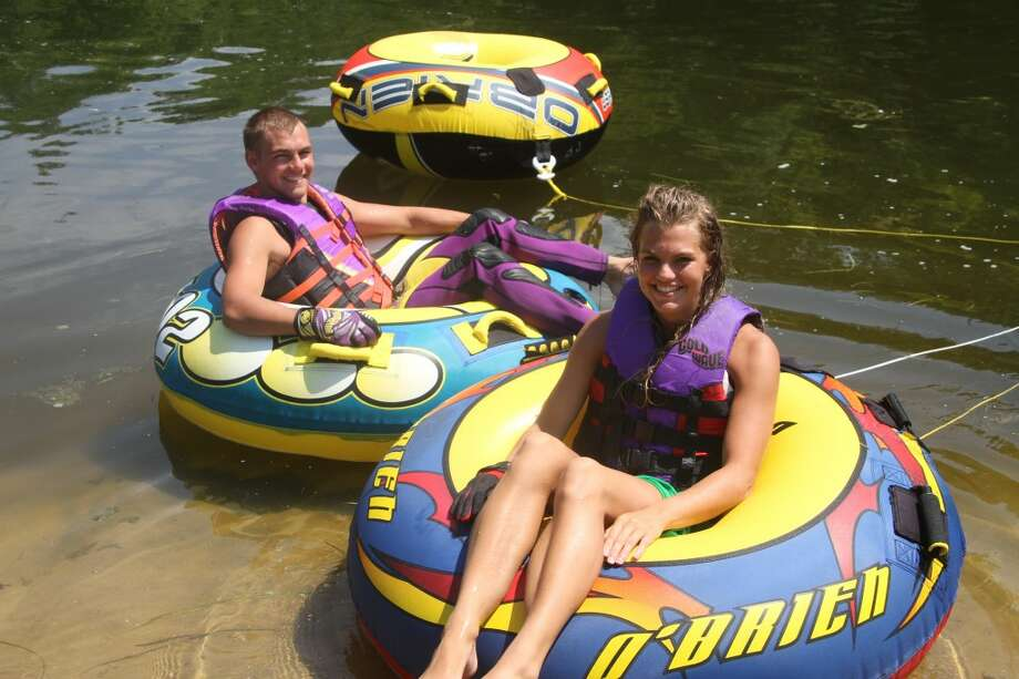 TUBING: As one of the few flat pieces of land along the Muskegon River in Mecosta County, Brower Park is a docking spot for many after a day of playing on the water. (Pioneer photo/Nico Rubello)