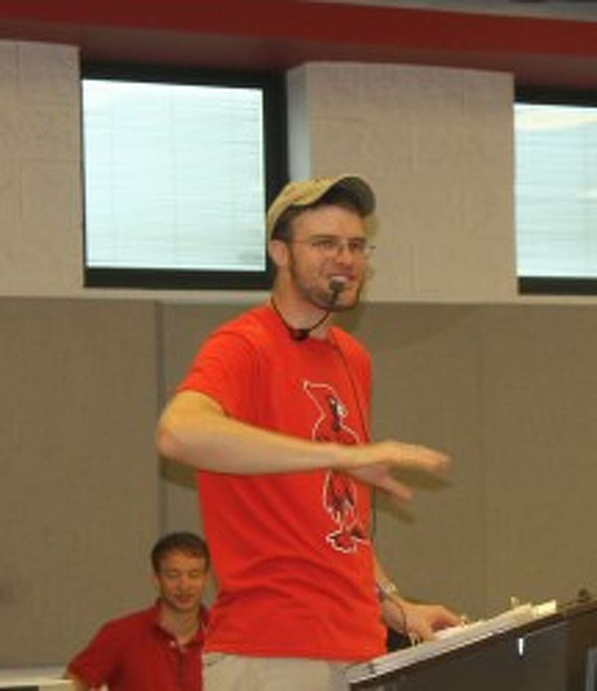 """photo_credit="""""""" MUSICAL GUIDE: Director Brian Balch leads the band in a warm-up on Tuesday. The band will perform a """"Methods of Madness"""" show at football games this fall."""