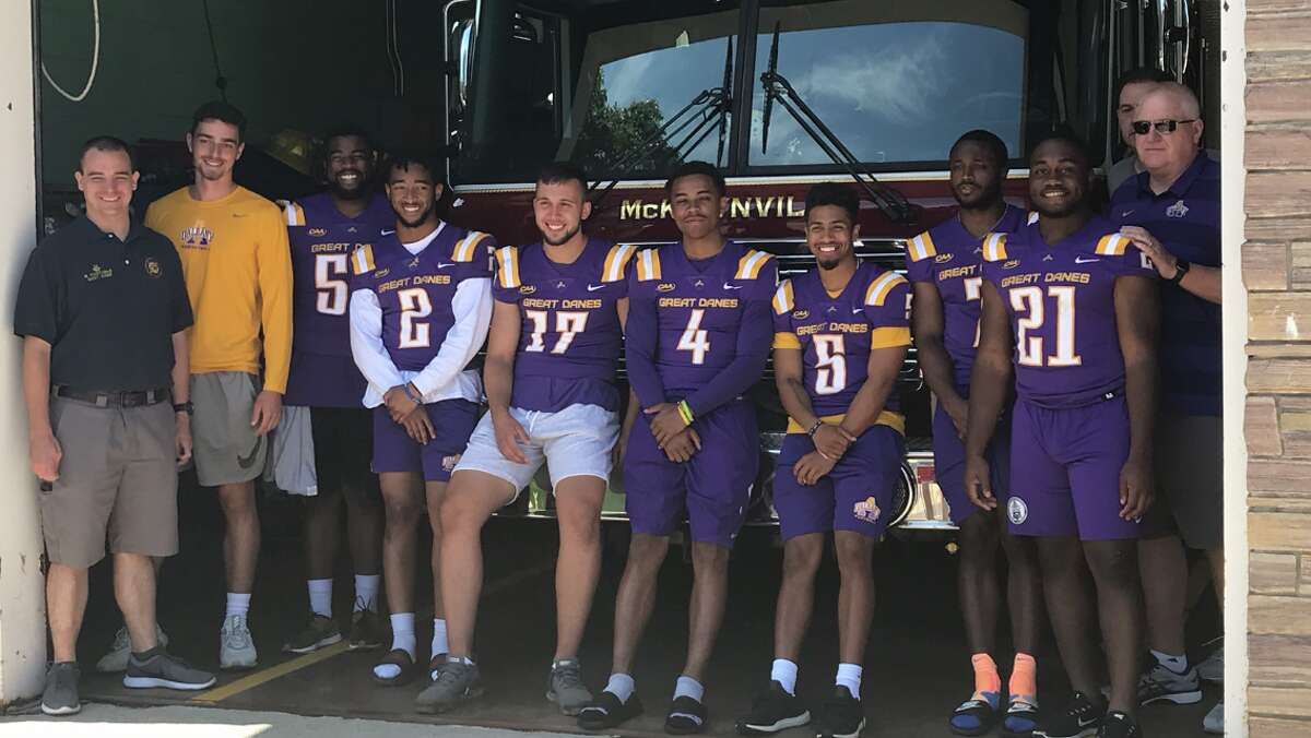 UAlbany football coach Greg Gattuso, far right, appeared with his players at the McKownville Fire Department to give away game tickets on July 24, 2019. (Mark Singelais)