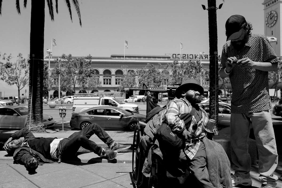 Embarcadero Plaza between Market Street and Sue Bierman Park. Alex Piersen (center), also known as Shorty, talks with his friend James Zito on June 18, 2019.