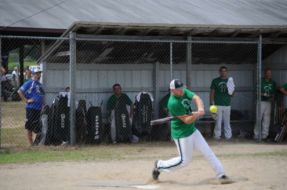 SWING: Players compete during the final games of the men's slow-pitch softball tournament at the Barryton Homecoming Days. It was a guaranteed win for Larry Cole who sponsored both of the teams competing for first place. (Pioneer photo/Kyle Leppek)