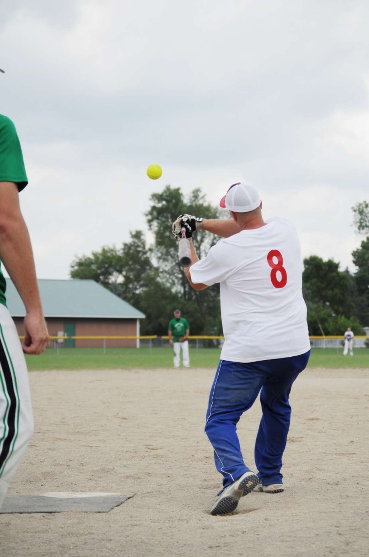 PITCH: The men's slow-pitch softball tournament ran Friday through Sunday during the Barryton Homecoming Days. The tournament, along with the festival, wrapped up on Sunday. (Pioneer photo/Kyle Leppek)
