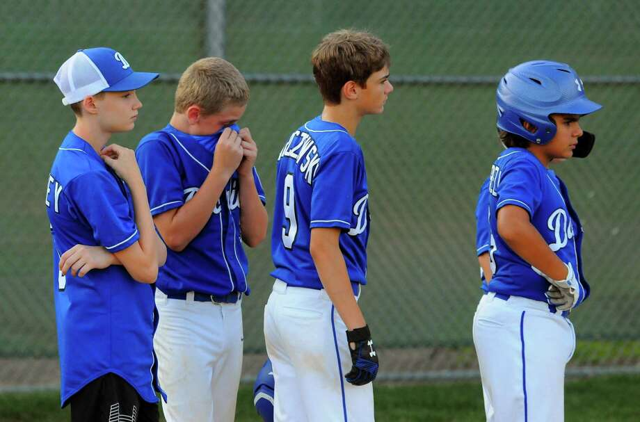 Darien team members line up at the conclusion of little league baseball action against North Haven at Unity Field in Trumbull, Conn., on Wednesday July 24, 2019. North Haven defeated Darien 7-1. Photo: Christian Abraham / Hearst Connecticut Media / Connecticut Post