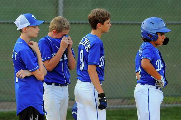 Darien team members line up at the conclusion of little league baseball action against North Haven at Unity Field in Trumbull, Conn., on Wednesday July 24, 2019. North Haven defeated Darien 7-1.