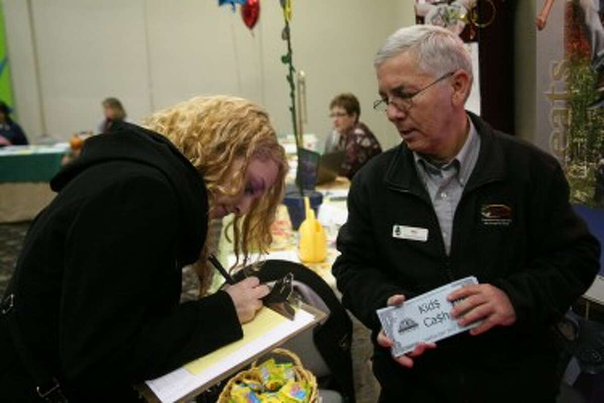 LEARNING TO GIVE BACK: Liz Valvano, a student at Ferris State University, made a donation to Cran-Hill Ranch on Tuesday during the 2012 Match Day. Her initial donation was matched 100 percent through the Mecosta County Community Foundation's kid's cash program, which was new to Match Day this year.