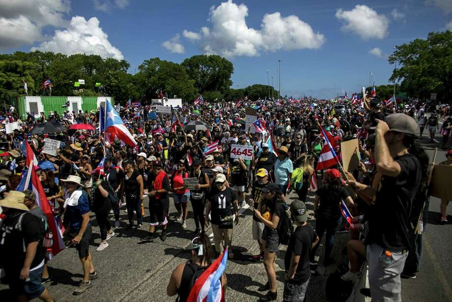 Demonstrators march on a highway blocking traffic during a protest in San Juan, Puerto Rico, onJuly 22, 2019. Photo: Bloomberg Photo By Xavier Garcia. / The Washington Post`