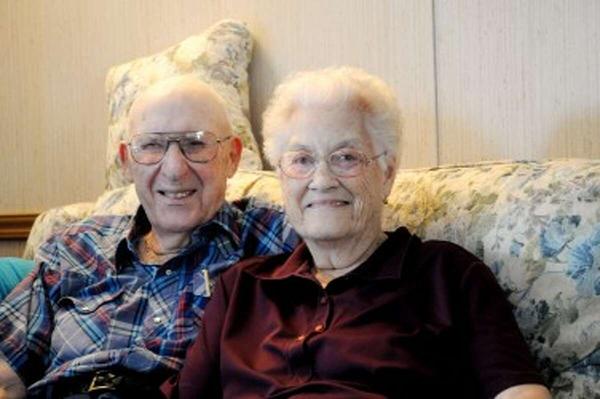 MARRIED: Seventy years ago today, Delbert McLachlan married Betty Plumhoff at her family home in Evart. Working together as partners in the marriage has helped it last more than half a cen- tury, they said. The couple will hold a celebration with friends and family from 2 to 5 p.m. on Oct. 8 at the VFW Hall in Evart. (Courtesy photo)