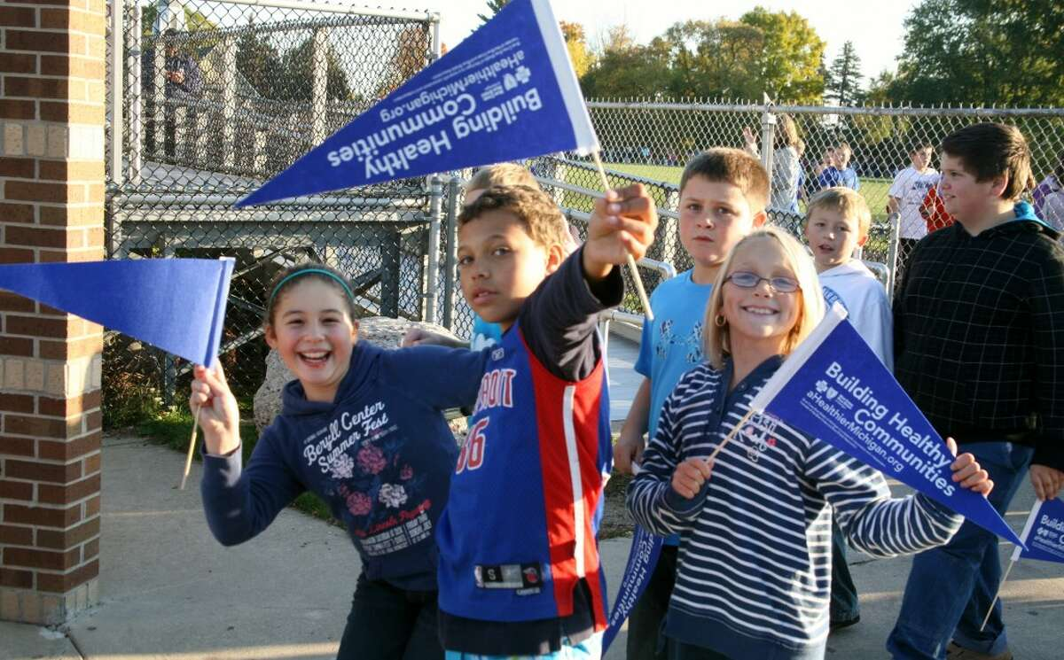 STAYING ACTIVE: G.T. Norman Elementary School students show off their flags and blue attire in support of a healthy community campaign funded by a $32,000 grant from Blue Cross Blue Shield. (Pioneer photos/Lauren Fitch)