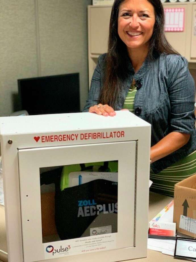 Cathy Geiger, director of fund development, is pictured with the new AED. (Photo Provided)