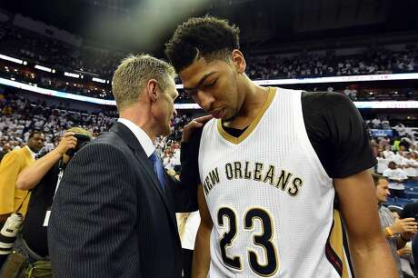 NEW ORLEANS, LA - APRIL 25:  Anthony Davis #23 of the New Orleans Pelicans speaks with head coach Steve Kerr of the Golden State Warriors following Game Four in the first round of the 2015 NBA Playoffs at the Smoothie King Center on April 25, 2015 in New